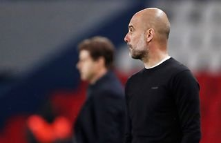 Manchester City manager Pep Guardiola watches on as his side face PSG in the Champions League