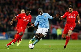 Liverpool's Kolo Toure and Manchester City's Yaya Toure in action