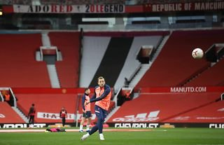 Tottenham Hotspur striker Harry Kane warms up at Old Trafford before playing Manchester United in the Premier League