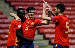 Spain's Miguel Gutierrez celebrates with his teammates after scoring