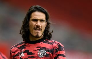 Manchester United's Edinson Cavani warming up after signing a contract extension