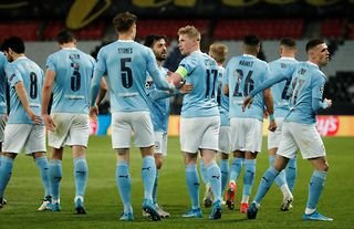 Manchester City players celebrate after scoring against PSG in the Champions League