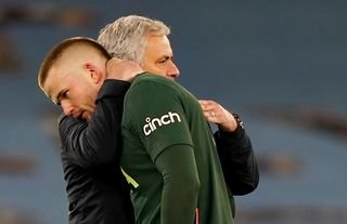 Tottenham defender and Roma target being embraced by Jose Mourinho