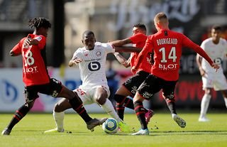 Lille midfielder and Leicester target Boubakary Soumare holding off 3 opponents