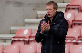 Brighton manager and potential Tottenham target Graham Potter clapping