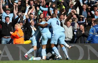 Sergio Aguero celebrates winning the title with Manchester City