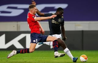 Manchester United target Sven Botman in action for Lille amid speculation over his future
