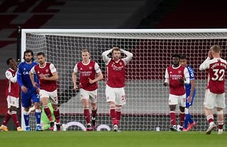 Arsenal players look dejected after losing to Everton at the Emirates Stadium in the Premier League