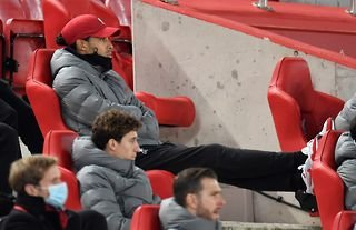 Injured Liverpool star Virgil van Dijk watches his side play Wolves in the Premier League at Anfield