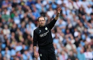 Martin O'Neill waves to supporters during his time in charge of Aston Villa