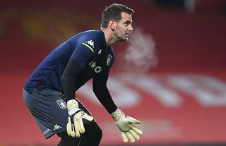 Tom Heaton warms up for Aston Villa at Manchester United's ground Old Trafford