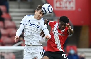 Leeds United defender Diego Llorente heads the ball against Southampton