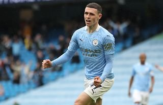 Phil Foden celebrates after scoring for Manchester City