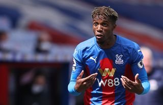Wilfried Zaha in action for Crystal Palace amid speculation over a transfer to Tottenham