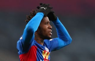 Crystal Palace winger Wilfried Zaha putting his hands on his head
