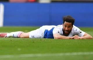 Crystal Palace winger Andros Townsend lying down on the pitch