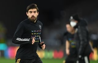 Wolves midfielder and Arsenal target Ruben Neves warming up