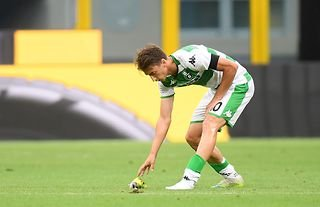 Sassuolo midfielder and West Ham target Filip Djuricic picking up his boot