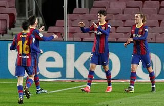 Barcelona winger and Wolves target Trincao celebrating with teammates