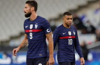 Olivier Giroud and Kylian Mbappe in action for France