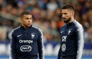 Kylian Mbappe and Olivier Giroud in action for France