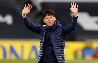 Tottenham winger Heung-min Son waving to the crowd at the end of the season