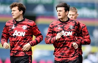Harry Maguire and Victor Lindelof warming up for Manchester United amid speculation that the Red Devils are looking for another centre-back