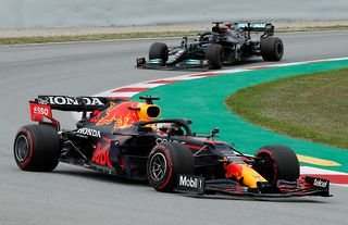 Red Bull's Max Verstappen and Mercedes' Lewis Hamilton in action during the race