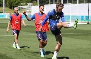 Jadon Sancho warming up at St George's Park ahead of Euro 2020