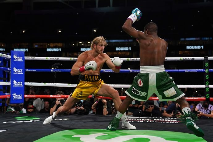 Floyd Mayweather in action against Logan Paul in exhibition match