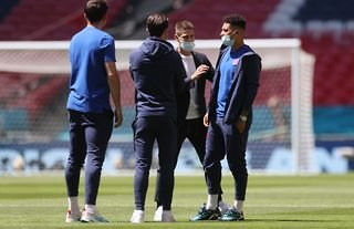 Sancho on the pitch before an England match amid speculation over a move to Manchester United