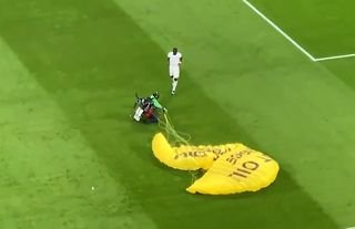 A parachutist made their way onto the pitch before Germany vs France