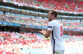 Tottenham striker and Man City target Harry Kane claps the fans at the Euros