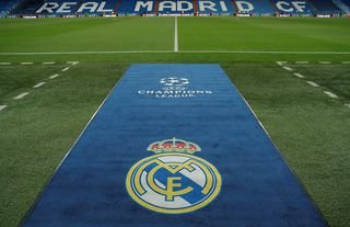 Real Madrid logo on the pitch at the Bernabeu
