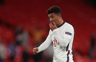 Jadon Sancho in action for England amid speculation over a move to Man United