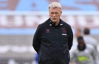 West Ham manager David Moyes with his hands behind his back