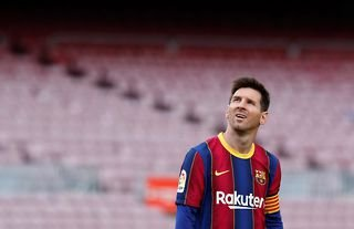 Barcelona captain Lionel Messi looking up into the stands