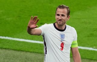 Tottenham striker Harry Kane waving to the Wembley crowd after an England game