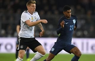 Toni Kroos and Marcus Rashford in action for Germany vs England