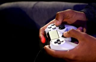 White PS4 controller being held