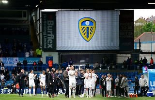 Leeds United players clap their fans at Elland Road