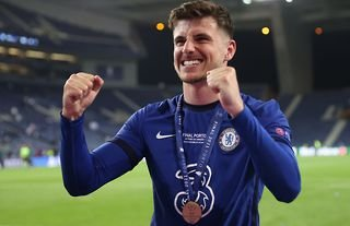 Mason Mount celebrates after winning the Champions League with Chelsea