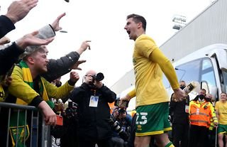 Kenny McLean celebrates winning promotion with Norwich City