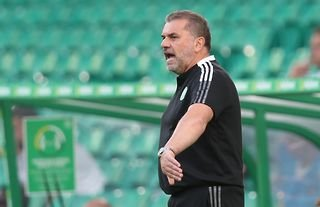 Celtic manager Ange Postecoglou gives instructions to his players