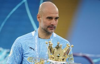 Pep Guardiola with the Premier League trophy amid speculation over a Man City move for Nuno Mendes