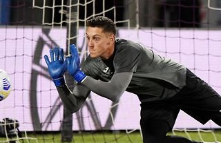Pierluigi Gollini warming up for Atalanta amid speculation over a move to Spurs