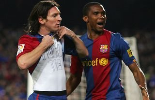 Lionel Messi and Samuel Eto'o in action for Barcelona