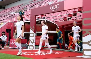 Alex Morgan, Rose Lavelle and Megan Rapinoe lead the USA out against Australia