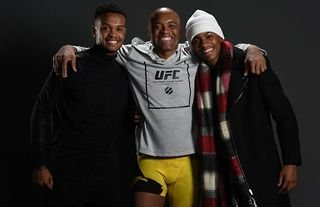 Anderson Silva poses with his sons Gabriel and Kalyl at UFC 208 in 2017