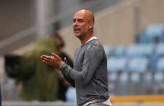 Man City manager Pep Guardiola encouraging his players